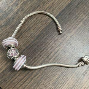 Pandora bracelet with 3 charms & stopper